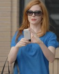 Rose McGowan using her iPhone. Probably not playing Wolfenstein.